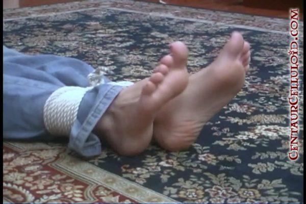 19 Year Old Blonde Bridgette Webb Tied Up Topless & Barefoot in Jeans