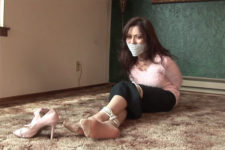 natasha flade plays tied and OTM gag game with son