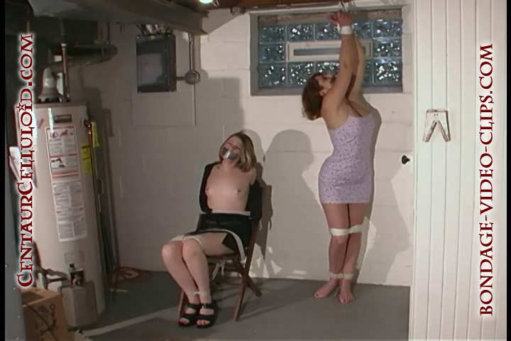 Miranda Capulet and Busty Redhead Veronica Chairtied Topless and Tapegagged Together in Bondage Video