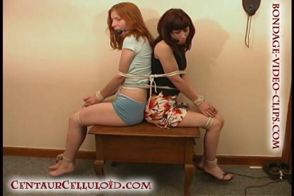 2 College Girls Tied Together and Ballgagged in Miniskirts on Table Top